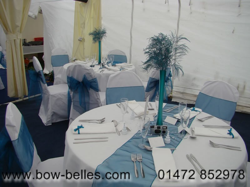 White Chair Covers And Teal Sashes