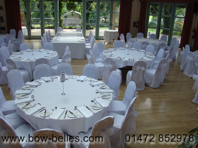 Wedding Chairs With White Organza Sashes